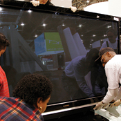 Resolution? I want one. Samsung's wide-screen high-def TV draws CES attendees.
