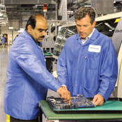 CIO Smoley (right, with general manager Zahid Hussain) takes a hands-on approach to quality control