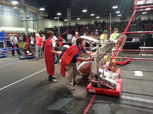 Competitors in the FIRST Robotics Competition get their machines ready to rumble at the Greater Ft. Lauderdale Convention Center