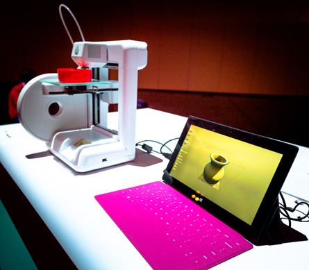 A 3D Systems Cube 3D Printer prints out a vase from a Surface RT tablet.
