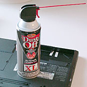 An inexpensive can of compressed air can help your cleaning immensely by providing highly controllable, highly directional, very intense bursts of air. The cans usually come with a long plastic nozzle that's ideal for working inside crevices and hard-to-reach places. Many brands of ''air in a can'' are available; your local office-supply or electronics store probably stocks several.