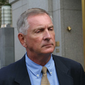Former Bowne CEO Johnson denies charges he downloaded child pornography at work.