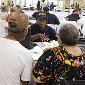 Hurricane Rita evacuees talk with a FEMA worker in the storm's aftermath.