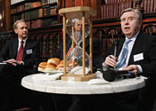 Microsoft lawyer Brad Smith (left) lunches with former European Parliament President Pat Cox (right) and Friends of Europe Secretary General Giles Merritt, before dropping a surprise on EC regulators.