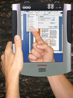 LucidTouch displays a virtual image of the user's hand.