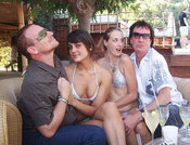 Andrea Feick and Hannah Emerson with U2 front man Bono and musician Simon Carmody in St. Tropez.