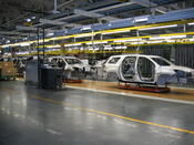 After auto bodies are made in the stamping and body shop sections of the plant and painted, they enter the assembly line at the GM Lansing Delta plant.