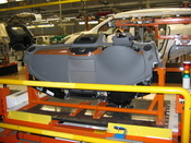 A Buick Enclave cockpit is ready to be assembled into a vehicle.