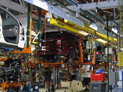 The body and chassis of a vehicle are married on the line at the GM Lansing Delta plant.