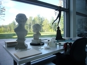 Busts awaiting evaluation or restoration before a north-facing window.