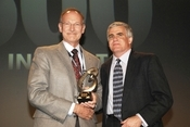 Dave Miller, FedEx's VP of IT, receives his award from InformationWeek VP and editor Rob Preston. FedEx ranked No. 10 this year and was the top company in the Logistics & Transportation category in the 2009 InformationWeek 500.