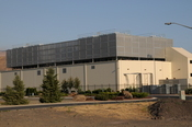One of two data center buildings with cooling towers at the Google facility.