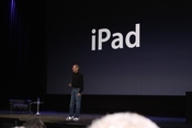 And now introducing, the iPad