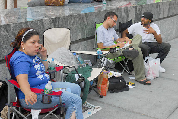 More iPhone fans join the line outside of an Apple story on Wednesday morning in Manhattan.