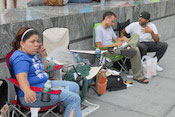 More iPhone fans join the line outside of an Apple story on Wednesday morning in Manhattan. -- Photo by Sacha Lecca